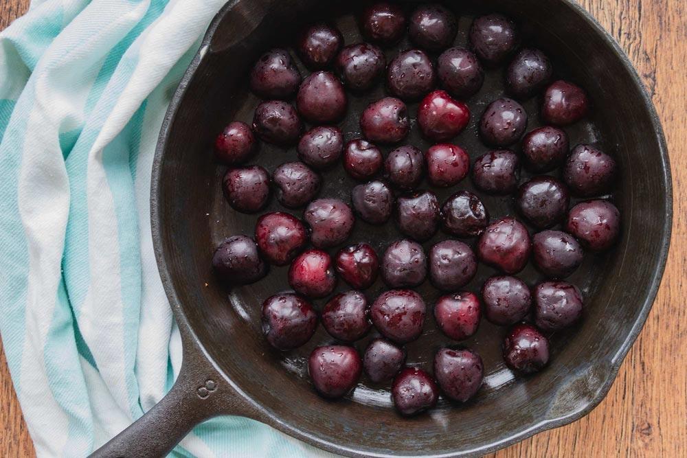 fresh summer cherries in a cast iron skillet