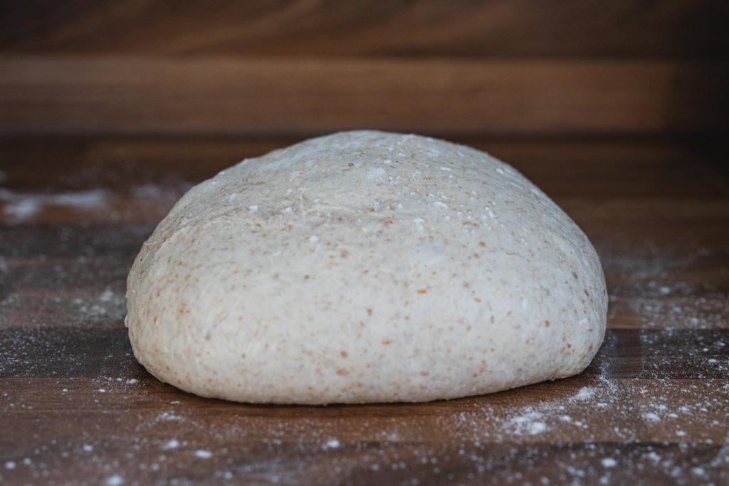 shaping a sourdough boule