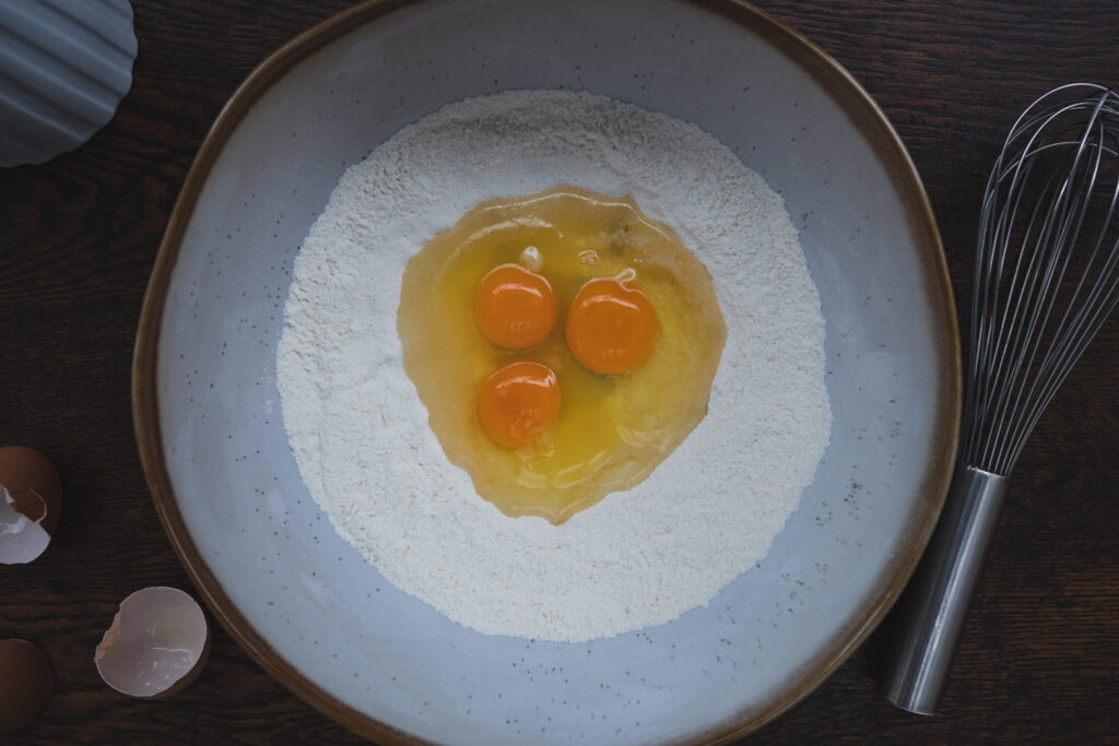 eggs and flour in a mixing bowl