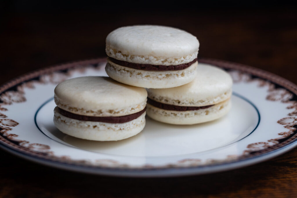 macarons stacked on a china plate
