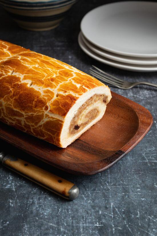 bejgli diós hungarian walnut roll on a wooden dish
