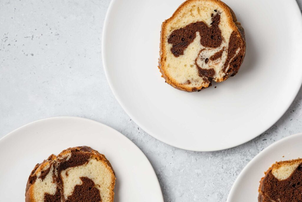 slices of marble cake on white plates